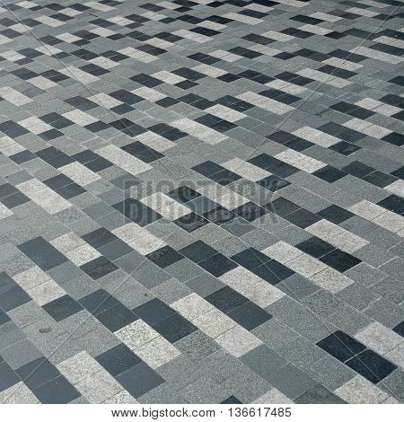Outdoor monotone tile floor as background. Exterior decoration.