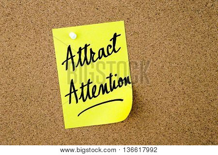Attract Attention Written On Yellow Paper Note