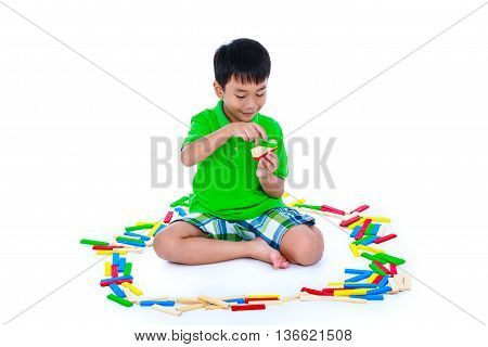 Asian Child Playing Toy Wood Blocks, Isolated On White Background.