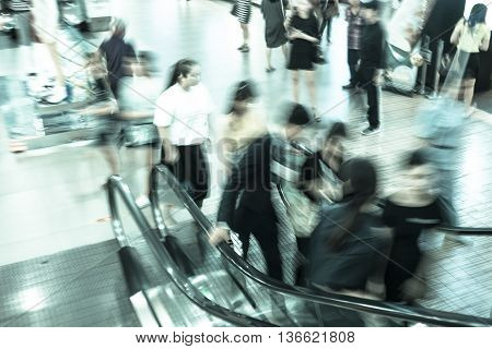 Motion blur people walking on escalator - cold filter effect