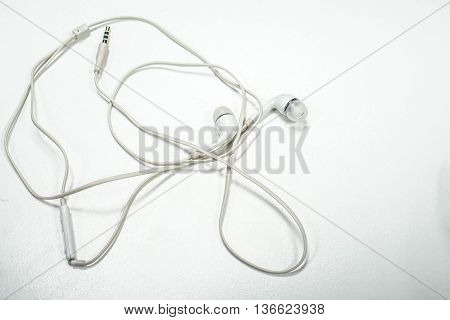 isolated white earphone for smartphone on the table