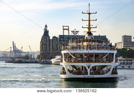 Istanbul, Turkey - May 29, 2016: Strait of Istanbul, Kadikoy Pier, Haydarpasa train station and Ferries.Ferries are the most popular form of public transport in Istanbul for one simple reason - if you're a local, you're always in a hurry except when you'r