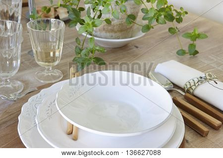 Traditional wooden table set decoration ready to use. Horizontal