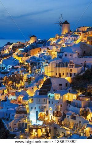 Lights of Oia village at night Santorini Greece.