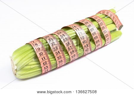 Zero calorie celery Raw celery wrapped in a tape measure