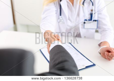 Female Medicine Doctor Shake Hand As Hello