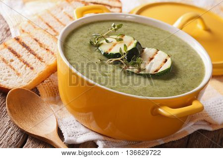Zucchini Soup Puree In A Close-up Yellow Saucepan And Toast. Horizontal