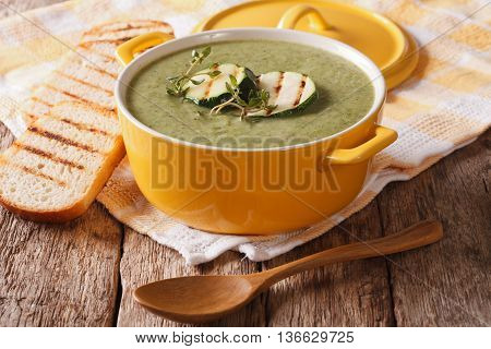 Thick Zucchini Soup Close-up In Yellow Saucepan And Toast. Horizontal