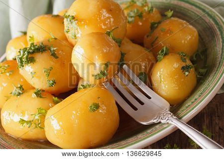 Caramelized New Potatoes With Herbs Close-up On A Plate. Horizontal