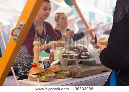 Ljubljana, Slovenia - April 10: People enjoing outdoor street food festival of Pivo and burger, Beer and Burger event, on April 10th, 2016 in Ljubljana, Slovenia.
