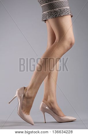 Sexy Long woman legs on grey background