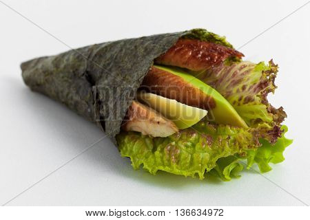 Temaki Sushi With Smoked Eel, Avocado And Lettuce On A White Background
