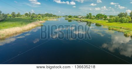 Summer panoramic landscape with small river Oril near Pekelne village in Ukraine