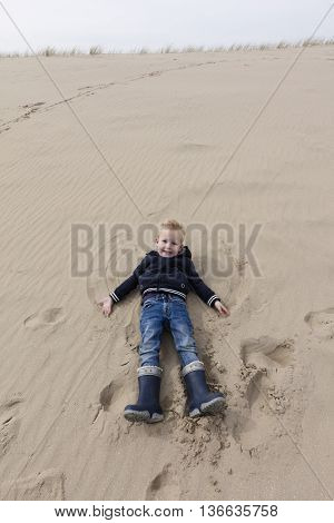 Young Boy Has Fun At Dutch Dunes