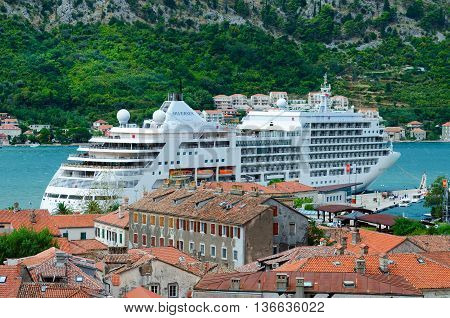 KOTOR MONTENEGRO - SEPTEMBER 21 2015: Top view of Old Town and cruise ship in Bay of Kotor Montenegro