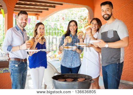 Friends Eating Together At A Barbecue