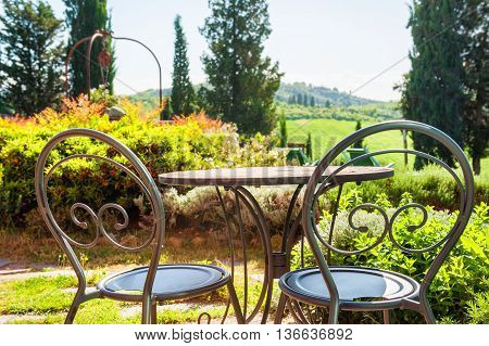 Two Chairs On The Terrace Of A Country House
