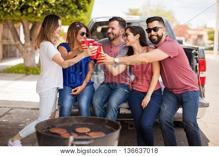 Group Of People Making A Toast With Plastic Cups