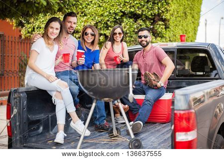 Friends Hanging Out On The Back Of A Pick Up Truck