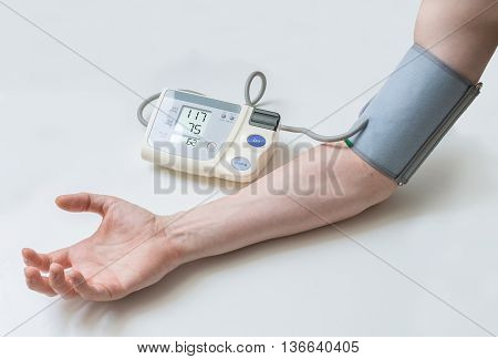 Patient Is Measuring Blood Pressure With Monitor.