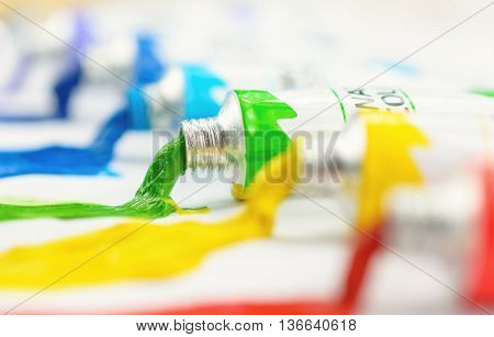 Colorful water colour in tubes on a white background