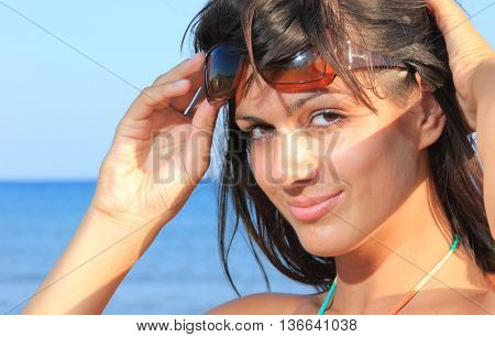 Woman suntanning at the beach