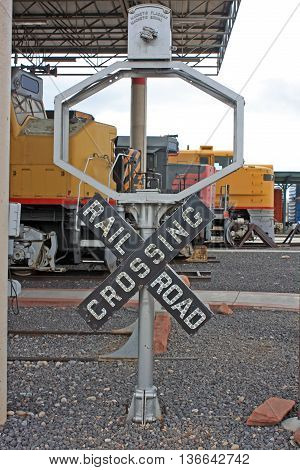 vintage railway crossing sign in a station