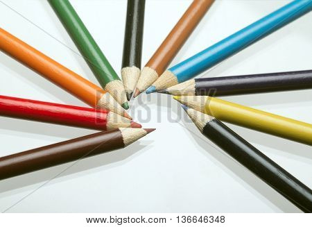 ten colored pastels mirrored on white background