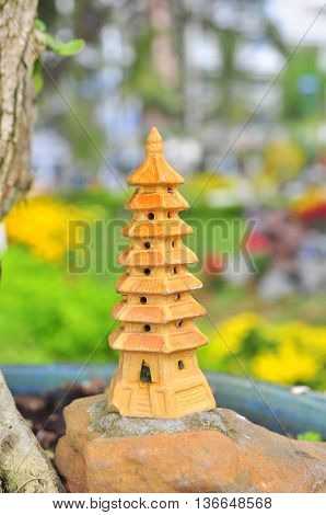 A bonsai temple tower in close up
