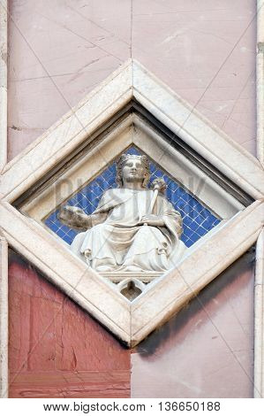 FLORENCE, ITALY - JUNE 05: Sun by Collaborator of Andrea Pisano, 1337-41, Giotto Campanile of Cattedrale di Santa Maria del Fiore (Cathedral of Saint Mary of the Flower), Florence, Italy, June 05,2015