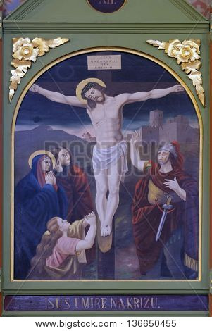 STITAR, CROATIA - NOVEMBER 24: 12th Stations of the Cross, Jesus dies on the cross, church of Saint Matthew in Stitar, Croatia on November 24, 2015
