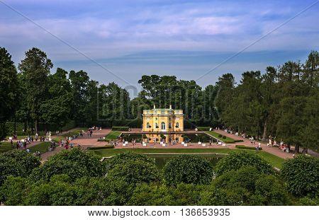 Saint-Petersburg, Russia - June 26, 2016: Pavilion near the pond in Tsarskoe Selo -Pushkin-. In the park the tourists walk.