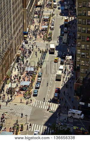 NEW YORK - JUNE 14, 2016: View down a busy street in New York, JUNE 14, 2016 in Manhattan, New York City, USA