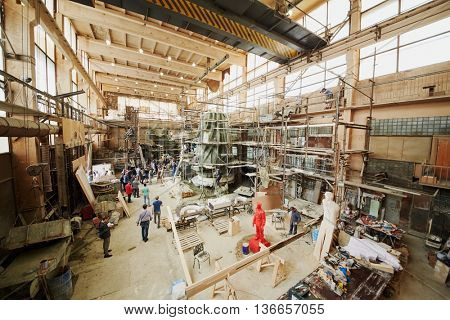 RUSSIA, MOSCOW - MAY 28, 2015: Press representatives and studio employees near clay sculpture to St. Prince Vladimir during manufacture in the workshop of sculptor Salavat Shcherbakov.