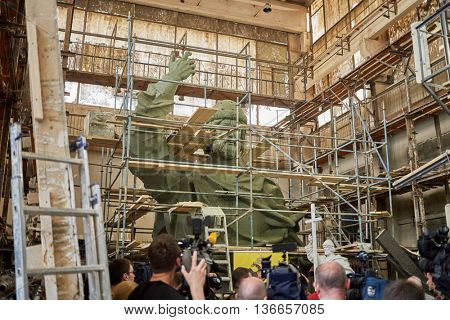 RUSSIA, MOSCOW - MAY 28, 2015: Press representatives near clay sculpture to St. Prince Vladimir during manufacture in the workshop of sculptor Salavat Shcherbakov.