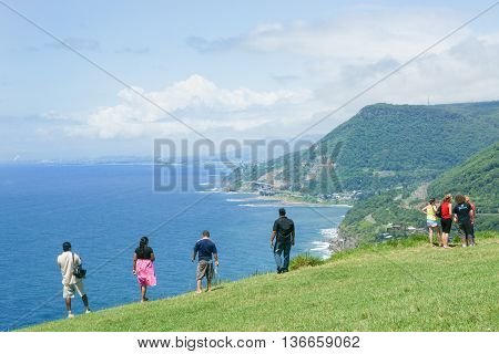 New South Wales, Australia - January 21, 2011; Tourists stop to take in view and the distant Sea Cliff Bridge which is a highlight along Grand Pacific Drive on New South Wales coastal route.