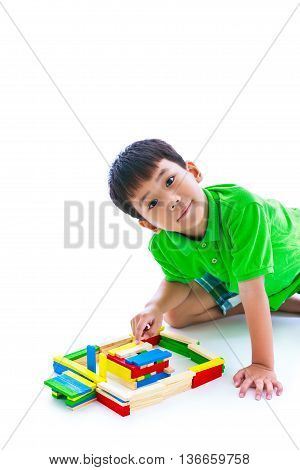 Asian Child Playing Toy Wood Blocks, Isolated On White Background.