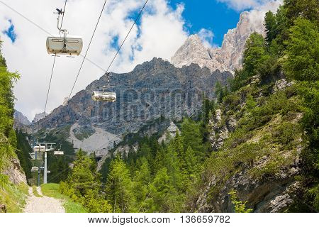 White cable car going to the Monte Cristallo Massif in the Dolomites Italy
