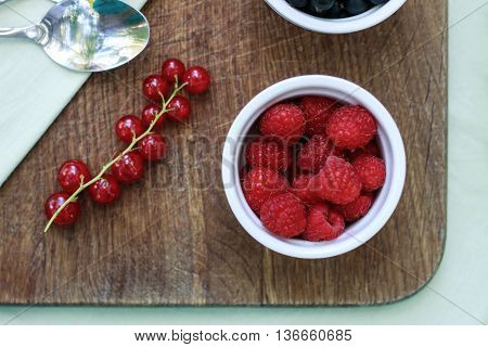 Assortment Of Berries - Raspberries, Gooseberries, Red Currants, Cherries, Black Currants On A White