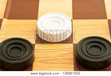 White And Black Plastic Checkers On Board