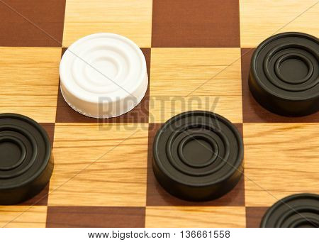 White And Black Plastic Checkers On A Board