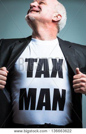 Man Opening Shirt With Tax Man Text