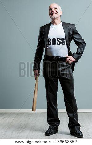 Happy Mature Boss Man With Bat