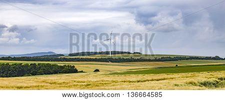 Wide Landscape With Wind Turbine In The Eifel