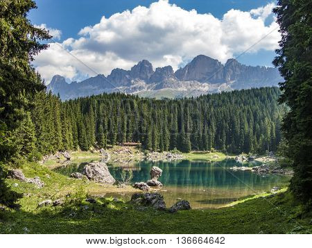 Perfectly clear emerald lake in the Dolomites