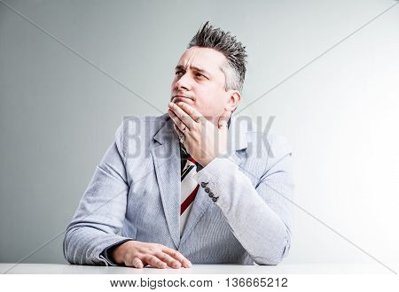 overweight business man thinking about many opportunities