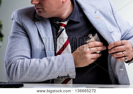 Office Worker Hiding A Flask In Internal Pocket