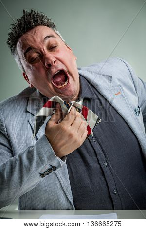 Businessman Sneezing On His Necktie