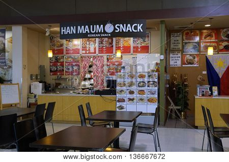 NAPERVILLE, ILLINOIS / UNITED STATES - NOVEMBER 3, 2015: The Han Ma Um Korean Snack concession offers Korean cuisine in the H Plaza food court in Naperville.