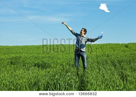 Man Throws The Paper In The Field